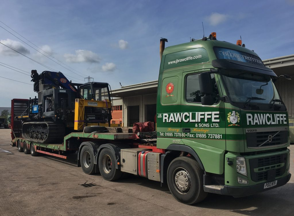 Tracked Machine with Crane on back of JB Rawcliffe & Sons Ltd Truck