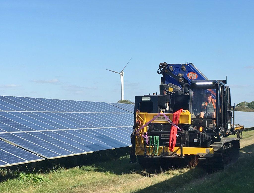 Solar Field, Wind Turbine and Tracked Machine with Crane